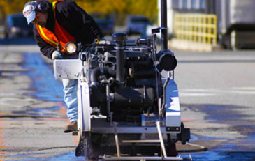 Asphalt Sawing Backhoes and Skidsteers with Hydraulic Breakers Manhole Boot Installation